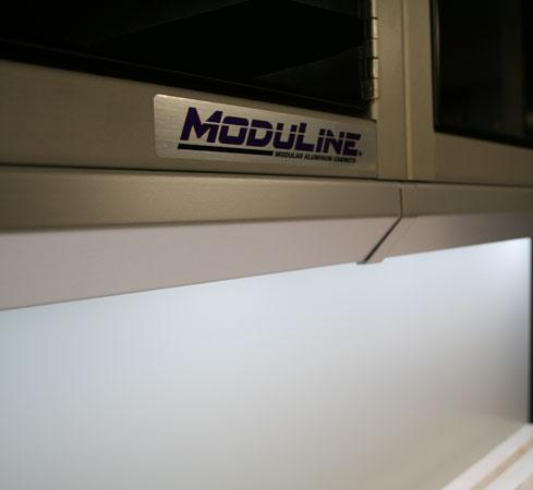 Light shield for garage shop cabinets